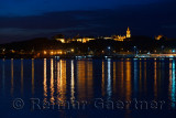 Topkapi Palace at early morning twilight with lights reflected in the Golden Horn Istanbul