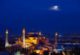 Night lights on Hagia Sophia under a full moon at twilight in Istanbul Turkey