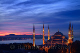 Lights on the Blue Mosque with red sky in the morning on the Bosphorus Sultanahmet Istanbul Turkey