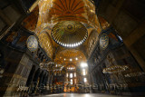 Ceiling domes in an empty Hagia Sophia Istanbul with chandeliers and wood roundels