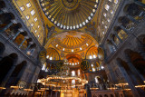 Ceiling domes and lit chandeliers with six winged Saraphim in the Hagia Sophia Istanbul