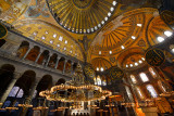 Golden ceiling domes and lit chandeliers in the Hagia Sophia Istanbul