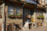 Woman standing at the door of a Historic Ottoman wooden house in Istanbul Turkey