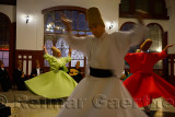 Spinning male and female Whirling Dervishes in a Sema Ceremony with musicians at Istanbul train station