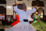 Male Sufi Whirling Dervish in a Sema Ceremony with musicians and women at Istanbul train station