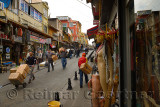 Coblestone street Uzun carsj Caddesi in Istanbul with shops and workers carrying boxes
