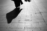 Shadow of a Muslem woman and two men walking on Eyup Sultan Boulevard Istanbul Turkey