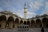 Minaret from inner courtyard with ablution fountain at Suleymaniye Mosque Istanbul Turkey