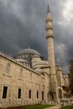 Front facade of Suleymaniye Mosque with storm clouds Istanbul Turkey