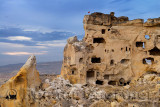 Cave dwelling in the abandoned ancient hilltop village of Cavusin in Cappadocia Turkey
