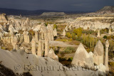 Sun breaking through on phallic Fairy Chimneys in Love Valley Goreme National Park Turkey with Cavusin and Avanos villages