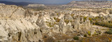 Panorama of phallic Fairy Chimneys in Love Valley Goreme National Park Turkey and Cavusin village