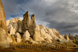 Evening sun on rock spires of the Red Valley with cave house Cappadocia Turkey