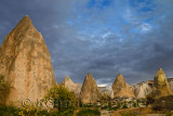 Evening light on pointed Rock spires of the Red Valley Cappadocia Turkey