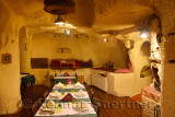 Interior of Urgup Evi rock house cave hotel dining room carved out of volcanic tuff in Cappadocia Turkey