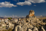 Broad view of Ortasihar rock Castle with minaret Mount Erciyes and fairy chimneys Cappadocia Turkey