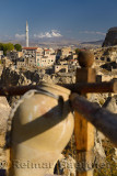Houses and Mosque in Ortasihar with Mount Erciyes and fairy chimneys and clay pot Cappadocia Turkey