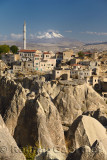 Houses and Mosque in Ortasihar with view of Mount Erciyes and fairy chimneys Cappadocia Turkey