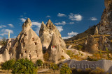 Ancient cave houses carved in volcanic tuff at Uchisar at sunset Cappadocia Turkey