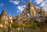 Fairy chimneys and ancient Uchisar Castle carved out of volcanic tuff Cappadocia Turkey