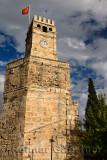 Saat Kulesi Clock Tower with Turkish flag on Roman wall in Castle Gate area of Antalya Turkey