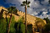 Roman stone wall or Kaleici surrounding Antalya harbour Turkey with palm trees