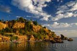 Cliffside resort and beach on Turkish Riviera at Antalya Kaleici Harbour Turkey at sunset