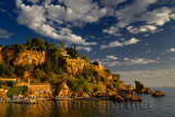 Cliffside resort on Turkish Riviera at Antalya Kaleici Harbour Turkey at sunset