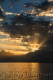 Mediterranean Sea at Antalya harbour Turkey with sunset God Rays over mountains