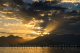 Mediterranean Sea at Antalya harbour Turkey with sunset sunbeams over mountains
