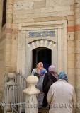 Turkish women entering the tomb of Fatma Hatun at Mevlana Museum Konya Turkey