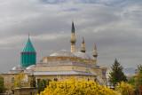Tomb of Rumi at Mevlana Museum with Selimiye and Aziziye mosque minarets Konya Turkey