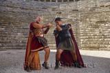 Roman Gladiators sword fighting on the stage at Aspendos theatre Turkey