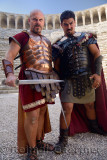 Roman Gladiators scowling before sword fight on stage at Aspendos theatre Turkey