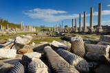 Collection of pillars in ruins of water canal on main street colonade of Perge Turkey