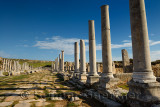 Colonade and canal on the main street of Perge archaeological site Turkey under the Acropolis