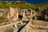 North Nymphaeum monument with fountain statue of River god Kestros at the foot of the Acropolis at Perge Turkey