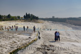 Visitors and tourists at the travertine terraces and thermal pools of Pamukkale Turkey