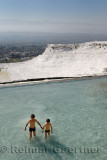 Two boys playing in mineral waters of travertine pools at Pamukkale Turkey