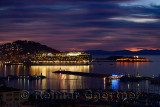 Kusadasi Turkey Harbour at twilight with Guvercin Adasi castle and cruise ship on the Aegean Sea