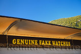 Ironic sign for genuine fake watches at the entrance to the ancient city of Ephesus Turkey