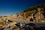 Basilica stoa royal porch at the state Agora with the Odeon at left and gymnasium at right in ancient Ephesus Turkey