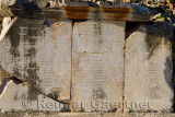 Latin inscription on stone blocks on Curetes street of ancient Ephesus Turkey