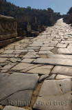 Worn stones of Curetes street in morning sun at ruins of ancient Ephesus Turkey