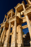 Facade of the Library and Mausoleum of Celsus with moon in blue sky at ancient city of Ephesus Turkey