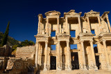 Ruins of the facade of the Library of Celsus with moon in blue sky at ancient city of Ephesus Turkey
