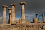 Dark clouds and Turkish flag at acropolis of Temple of Athena Assos Behramkale Turkey