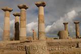 Six Greek columns and Turkish flag at acropolis ruins of Temple of Athena Assos Behramkale Turkey