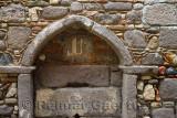 Elaborate stonework in wall at hamlet village of Assos Iskele Turkey