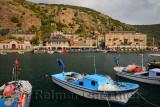 Cliffside village hamlet of Assos Iskele or Behram Turkey with boats hotels and restaurants
